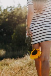 Woman with Sunflower | Suzanne Polino REALTOR